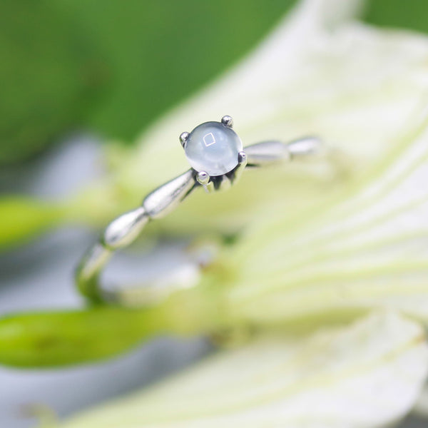Dainty silver band with round moonstone gemstone in prongs setting - Metal Studio Jewelry