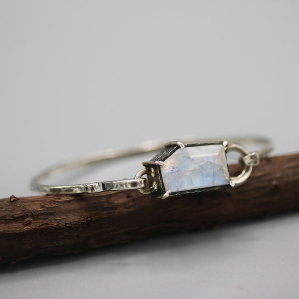 Faceted moonstone bracelet in silver bezel and prongs setting with oxidized sterling silver with texture band