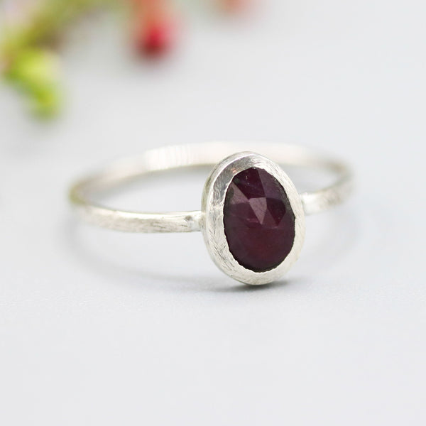 Tiny oval ruby ring in silver bezel setting with sterling silver brush textured matte finish band - Metal Studio Jewelry