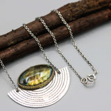 Oval Labradorite pendant necklace in brass bezel setting with silver fan on oxidized sterling silver chain
