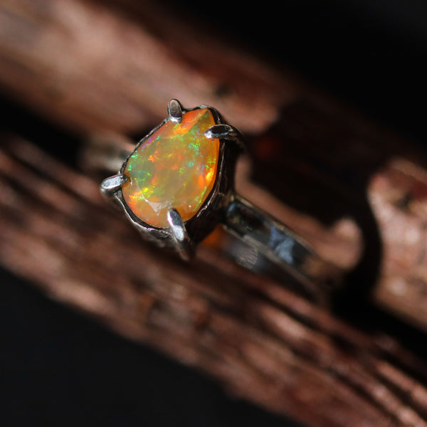 Teardrop faceted opal ring in silver bezel and prongs setting with sterling silver hammer texture design band - Metal Studio Jewelry