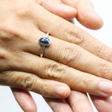 Oval blue sapphire ring in bezel setting with sterling silver hammer texture band