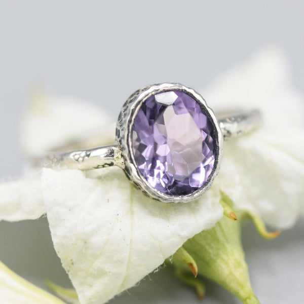 Oval Amethyst ring in silver bezel setting with sterling silver oxidized engraving technique band - Metal Studio Jewelry