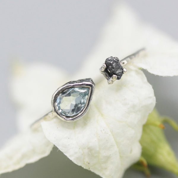 Teardrop blue topaz ring and natural rough diamond in silver bezel and prongs setting with sterling silver band