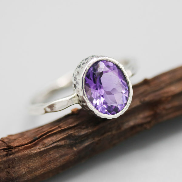 Oval Amethyst ring in silver bezel setting with sterling silver hammer textured oxidized band