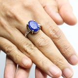 Oval faceted Lapis lazuli ring in silver bezel and brass prongs setting with sterling silver hard texture band