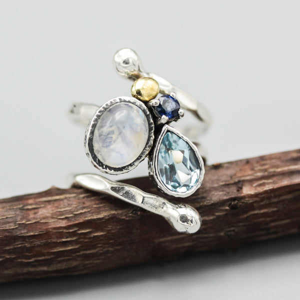 Oval moonstone, blue sapphire and blue topaz ring in silver bezel and prongs setting with sterling silver wrap band - Metal Studio Jewelry