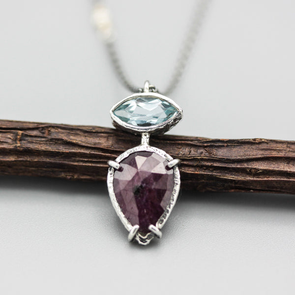 Teardrop Red Ruby necklace and marquise blue topaz in silver bezel and prongs setting