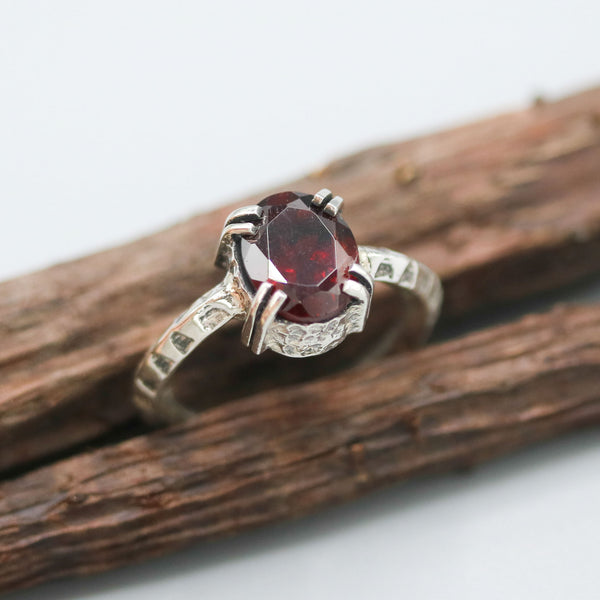 Oval Garnet ring in silver bezel and double prongs setting in sterling silver oxidized hard texture band - Metal Studio Jewelry
