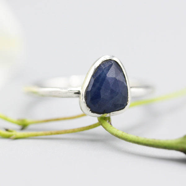 Triangle faceted blue sapphire ring in bezel setting with sterling silver high polished band