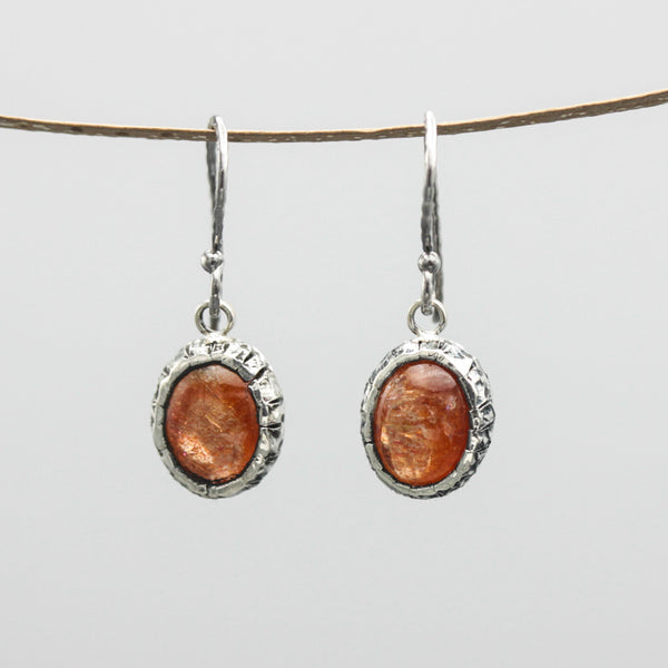 Oval Sunstone earrings in silver bezel setting with sterling silver oxidized hooks style - Metal Studio Jewelry