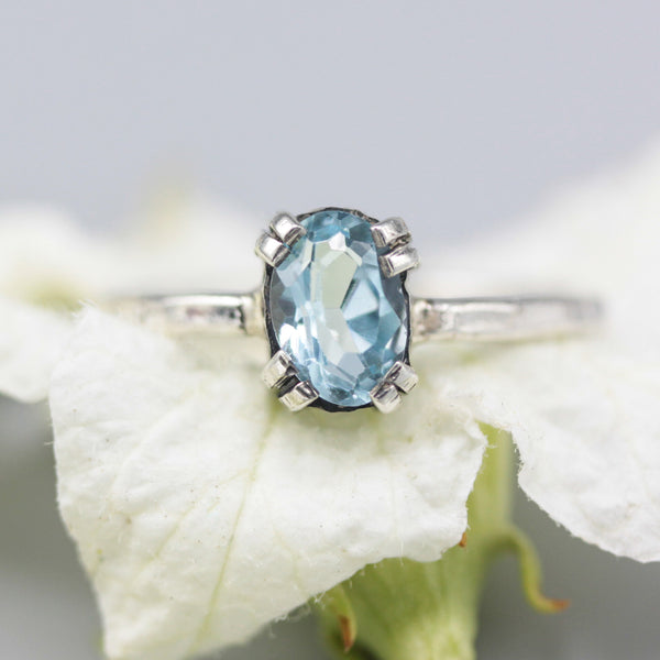 Oval Swiss blue topaz ring in silver bezel and prongs setting with sterling silver band - Metal Studio Jewelry