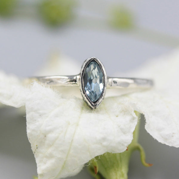 Marquise shape blue topaz ring in silver bezel setting with sterling silver texture band - Metal Studio Jewelry