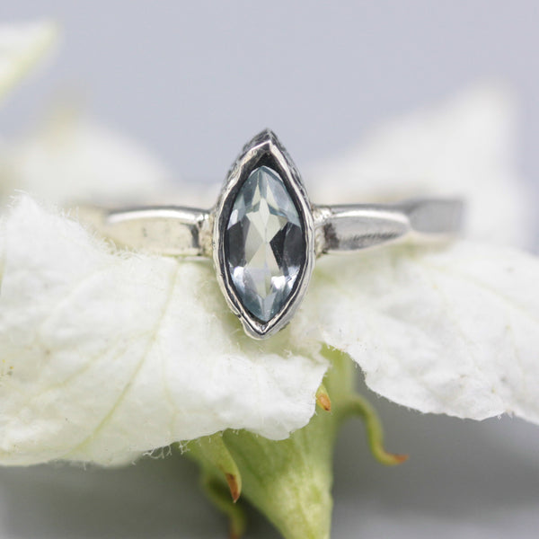 Marquis Swiss blue topaz ring in silver bezel setting with sterling silver band - Metal Studio Jewelry