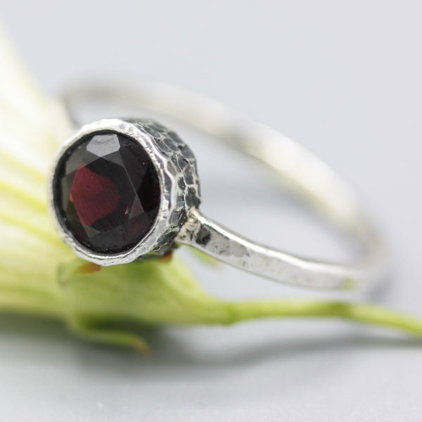 Round faceted garnet ring in silver bezel setting with sterling silver hammer band - Metal Studio Jewelry