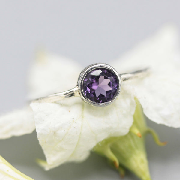 Round faceted amethyst ring in silver bezel setting with sterling silver band - Metal Studio Jewelry