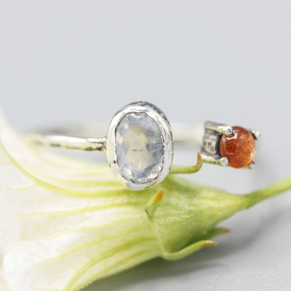 Oval moonstone and tiny sunstone ring in bezel and prongs setting with sterling silver texture band - Metal Studio Jewelry