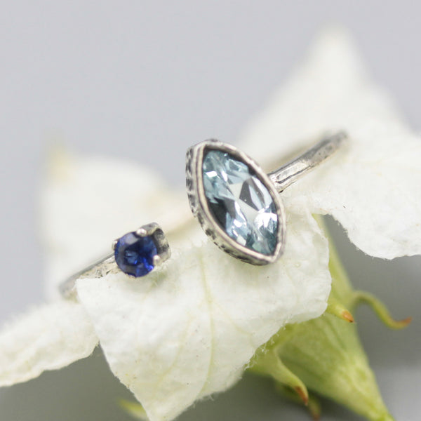 Faceted Swiss blue topaz ring and blue sapphire in bezel and prongs setting with sterling silver band - Metal Studio Jewelry