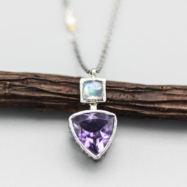 Trillion faceted amethyst pendant necklace in silver bezel setting with square moonstone on the top