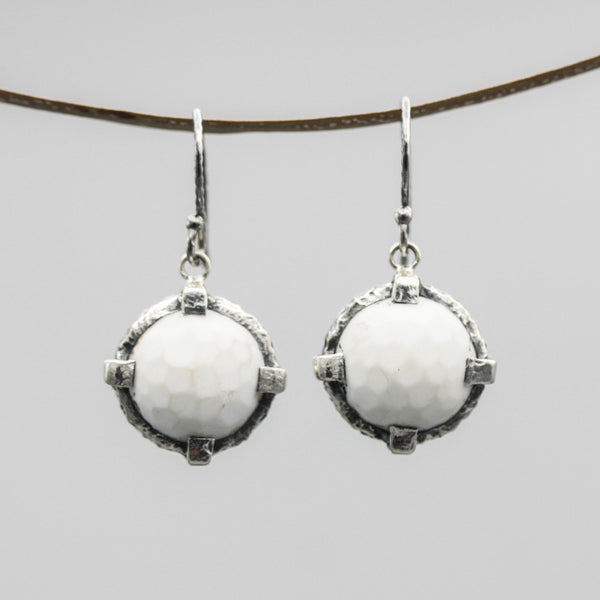Round faceted white onyx earrings in silver bezel and prong setting with oxidized sterling silver hooks