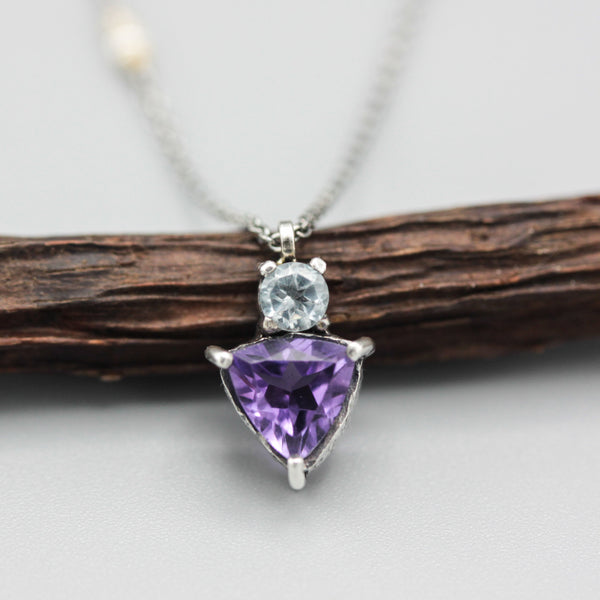 Triangle Amethyst pendant necklace in silver bezel and prongs setting with tiny blue topaz on the top