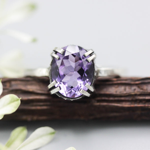 Faceted oval purple amethyst ring with sterling silver band - Metal Studio Jewelry