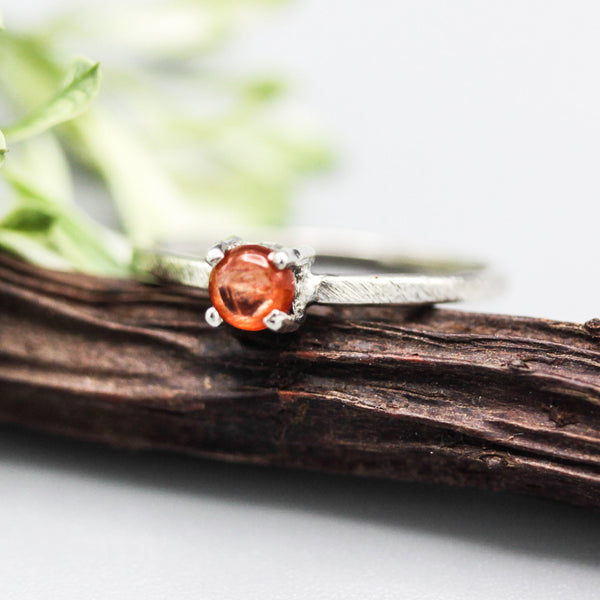 Tiny round sunstone ring in prongs setting with sterling silver scratch texture band - Metal Studio Jewelry