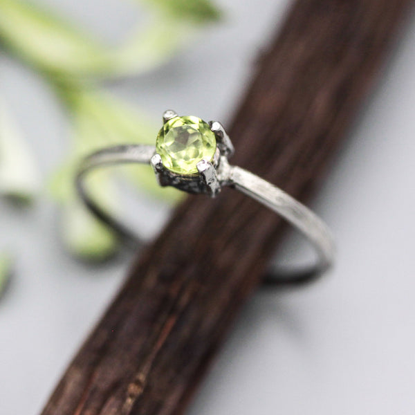 Tiny round peridot ring in prongs setting with sterling silver scratch texture band - Metal Studio Jewelry