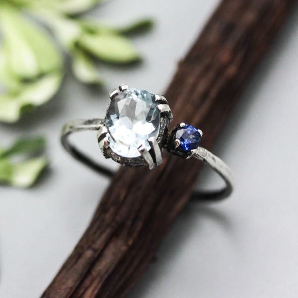 Oval faceted blue topaz ring and blue sapphire in silver double prongs setting with sterling silver texture band - Metal Studio Jewelry