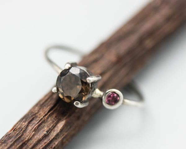 Faceted smokey quartz ring in silver prong setting with secondary garnet gemstone in 2mm silver round band - Metal Studio Jewelry