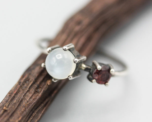 Round moonstone ring in prongs setting and tiny garnet on the side with sterling silver high polished band - Metal Studio Jewelry