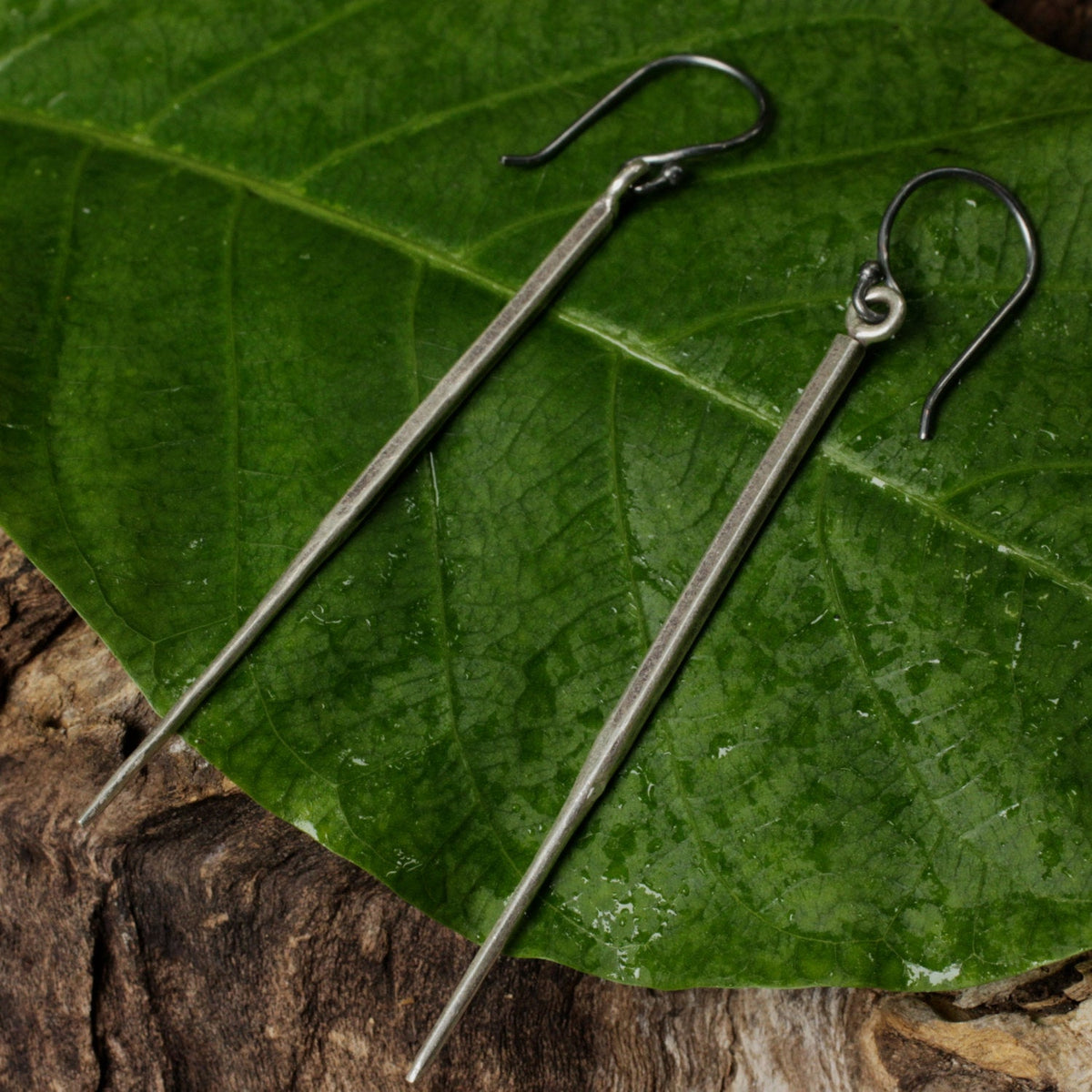 Silver spike earrings with oxidized silver