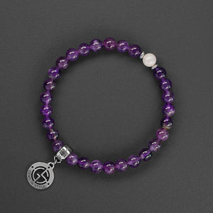Amethyst and Rose Quartz natural gemstone bracelet with silver charm by Gems In Style Jewellery.