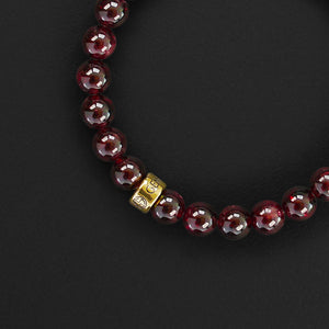 Garnet natural gemstone bracelet with branded gold charm by Gems In Style Jewellery. Customised size, comes in a gift box.