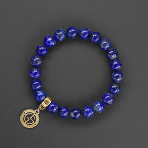 Lapis Lazuli natural gemstone bracelet with branded gold charm by Gems In Style Jewellery.
