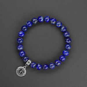 Lapis Lazuli natural gemstone bracelet with silver charm by Gems In Style Jewellery.