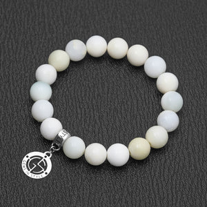 Light Green Opal gemstone bracelet with silver charm