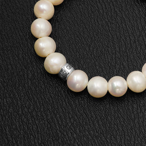Freshwater Pearl gemstone bracelet with silver bead by Gems In Style Jewellery.