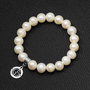 Freshwater Pearl gemstone bracelet with silver charm by Gems In Style Jewellery