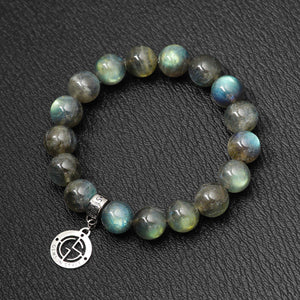 Labradorite gemstone bracelets with silver charm. High quality gemstone with strong colour flashes