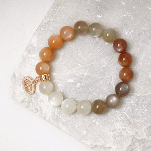 Moonstone gemstone bracelets with rose 14 karat gold plated silver charms by Gems In Style Jewellery.