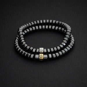 Hematite gemstone bracelets with gold and silver charms by Gems In Style Jewellery