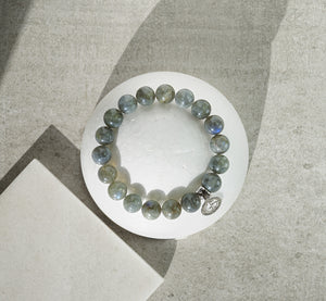 Labradorite natural gemstone bracelet with silver charm by Gems In Style Jewellery.