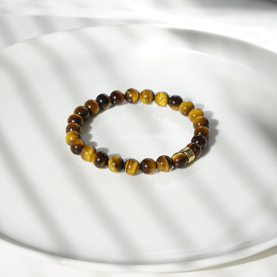 Tiger Eye natural gemstone bracelet with gold charm by Gems In Style Jewellery.