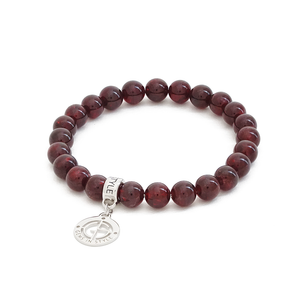Garnet natural gemstone bracelet with silver charm by Gems In Style Jewellery.