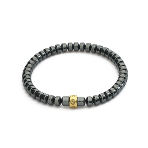 Hematite gemstone bracelet with gold charm by Gems In Style Jewellery.