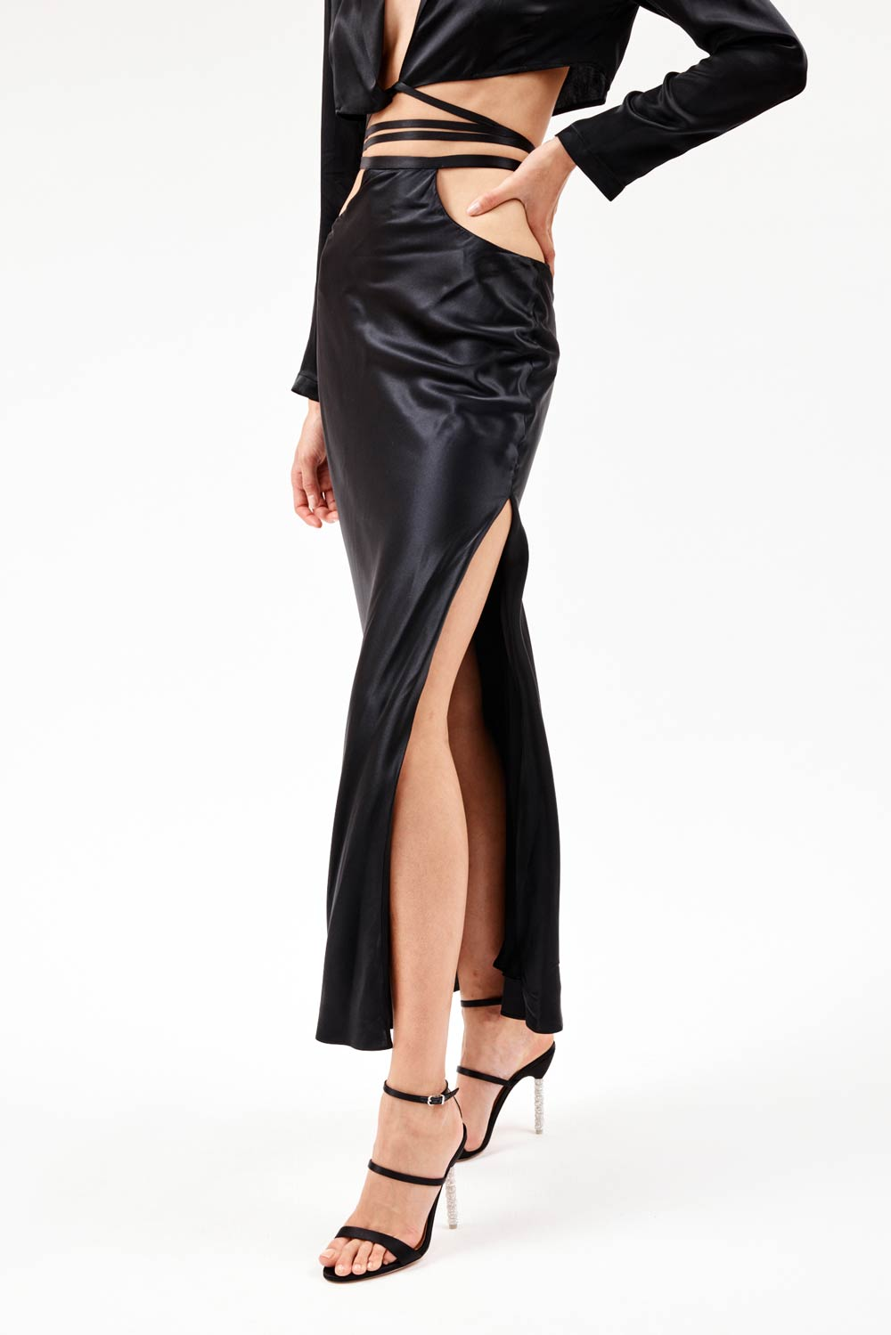 Cut out black silk skirt