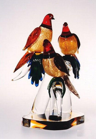 Colourful Murano glass doves on a crystal base