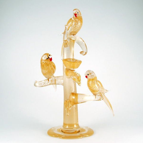 Murano glass birds in gold on a tree with nests