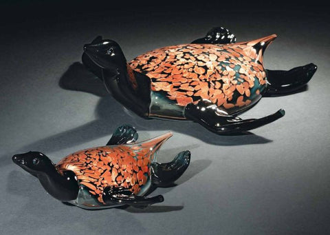 Murano glass turtles in black and speckled amber